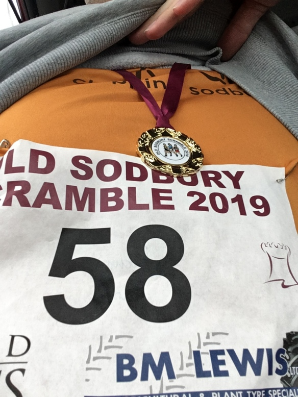 Race nu,mber and medal from the Old Sodbury Scramble 2019
